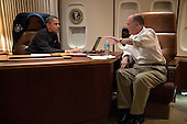United States President Barack Obama talks with National Security Advisor Tom Donilon before a phone call with President Mohammed Morsi of Egypt, aboard Air Force One during the flight from Phnom Penh, Cambodia, to Washington, D.C., November 20, 2012. .Mandatory Credit: Pete Souza - White House via CNP