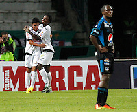 MANIZALES - COLOMBIA - 04-07-2013: Jugadores de Once Caldas celebran el gol anotado durante el partido en el estadio Palogrande de la ciudad de Manizales, julio 4 de 2013. Once Caldas y Millonarios durante partido por la sexta fecha de las semifinales de la Liga Postobon I. (Foto: VizzorImage / Yonboni / Str).The Players of Once Caldas celebrate a goal scored  during a game in the Palogrande Stadium in Manizales city, July 4, 2013. Once Caldas and Millonarios in a match for the sixth round of the semifinals of the Postobon I League. (Photo: VizzorImage / Yonboni / Str).