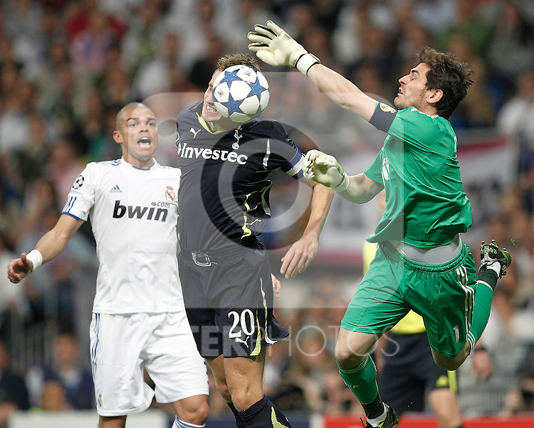 Real Madrid's Iker Casillas and Tottenham's Michael Dawson during Champions League match on April, 5th 2011...Photo: Cesar Cebolla / ALFAQUI