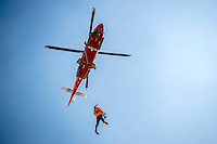 After navigating the Mary Maersk, the largest container ship in the world, through the narrow waterways leading from Bremerhaven to the open sea, the local pilot is winched onto a helicopter and taken back to shore.