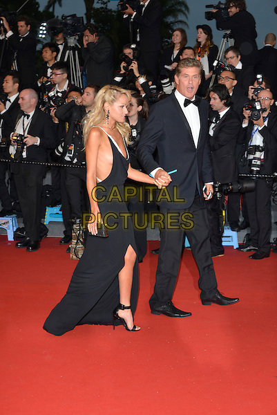 Hayley Roberts,  David Hasselhoff.Opening ceremony and 'The Great Gatsby' premiere at  the 66th International Cannes Film Festival, France 15th May 2013.full length black dress sleeveless tuxedo couple holding hands side profile slit split .CAP/PL.©Phil Loftus/Capital Pictures.