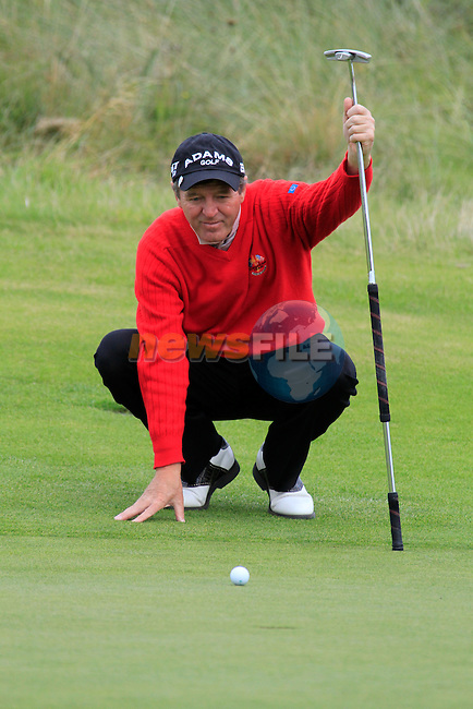 Des Smyth lines up his putt on the 18th green during Day 3 of the 100th Irish PGA championship at Seapoint Golf Club, Co Louth...Picture Eoin Clarke/www.golffile.ie.