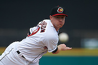 Rochester Red Wings pitcher Cole Johnson (19) follows through on a pitch during a game against the Pawtucket Red Sox on July 1, 2015 at Frontier Field in Rochester, New York.  Rochester defeated Pawtucket 8-4.  (Mike Janes/Four Seam Images)