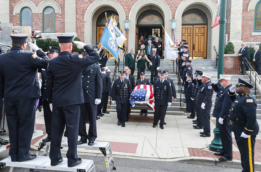 Dozens of first responders stand at attention as the flag-draped casket containing the remains of Manasquan volunteer firefighter Dan McCann is carried out of St. Cecilia's Church in Kearny after McCann's funeral mass. McCann, a firefighter EMT with more than 25 years experience, died last week after a fire department training exercise.  9/21/16  (Andrew Mills | NJ Advance Media for NJ.com)
