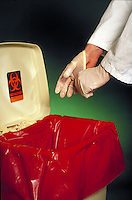 Gloves placed in biohazard waste container