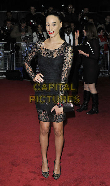 Elarica Gallacher.UK film premiere of 'Demons Never Die' held at the Odeon West End - Arrivals.London, England..October 10th, 2011.full length black lace dress hand on hip clutch bag.CAP/CAN.©Can Nguyen/Capital Pictures.