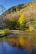 Autumn foliage along the Saco River in Hart's Location of the New Hampshire White Mountains during the autumn months. This section of the Saco River is within the scenic Crawford Notch State Park.