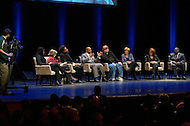 January 12, 2012  (Washington, DC)  Radio and television talk show host Tavis Smiley moderated a panel discussion on restoring America's prosperity at the George Washington University Lisner Auditorium in Washington. (L-R seated) Majora Carter, Barbara Ehrenreich, Dr. Cornell West, Tavis Smiley, Michael Moore, Suze Orman, Vicki Escarra, Roger Clay, Jr.  (Photo by Don Baxter/Media Images International)