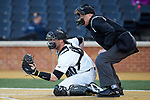 Wake Forest Demon Deacons catcher Shane Muntz (11) frames a pitch as home plate umpire Frank Sylvester looks on during the game against the Florida State Seminoles at David F. Couch Ballpark on March 9, 2018 in  Winston-Salem, North Carolina.  The Seminoles defeated the Demon Deacons 7-3.  (Brian Westerholt/Sports On Film)