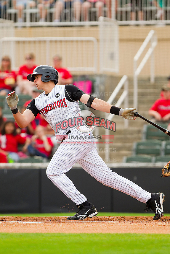 Mike Blanke #32 of the Kannapolis Intimidators follows through on his swing against the West Virginia Power at Fieldcrest Cannon Stadium on April 20, 2011 in Kannapolis, North Carolina.   Photo by Brian Westerholt / Four Seam Images