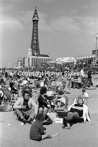 Crowded beach and Blackpool Tower, Blackpool, Lancashire.  1974