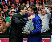 Ronnie O'Sullivan embraces Jimmy White after winning the Dafabet Masters FINAL between Barry Hawkins and Ronnie O'Sullivan at Alexandra Palace, London, England on 17 January 2016. Photo by Liam Smith / PRiME Media Images