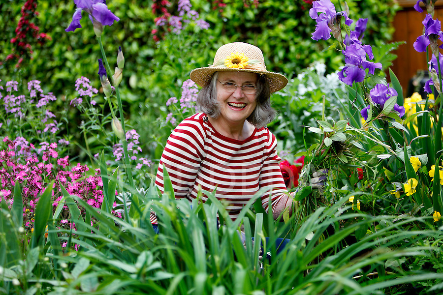 Mary Ann Bodenberg works in her backyard flower and vegetable garden at her home in Victoria, British Columbia. Photo assignment for the Globe and Mail national newspaper in Canada.