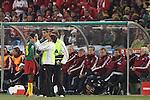 19 JUN 2010: Cameroon training staff tend to Eyong Enoh (CMR) (18) as Denmark head coach Morten Olsen (DEN) (far right) and the Denmark technical staff look on. The Denmark National Team defeated the Cameroon National Team 2-1 at Loftus Versfeld Stadium in Tshwane/Pretoria, South Africa in a 2010 FIFA World Cup Group E match.