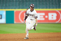 Hunter Vansau (32) of the Mississippi State Bulldogs celebrates as he rounds second base, thinking hit hit a 2-run home run, but he was thrown out at third base during the game against the Houston Cougars in game six of the 2018 Shriners Hospitals for Children College Classic at Minute Maid Park on March 3, 2018 in Houston, Texas. The Bulldogs defeated the Cougars 3-2 in 12 innings. (Brian Westerholt/Four Seam Images)