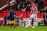 7th March 2020; Bet365 Stadium, Stoke, Staffordshire, England; English Championship Football, Stoke City versus Hull City; Sam Clucas of Stoke City kicks the ball around with a mascot before the start
