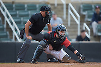 Kannapolis Intimidators catcher Gunnar Troutwine (37) reaches for a pitch in the dirt as home plate umpire Thomas O'Neil looks on during the game against the Hagerstown Suns at Kannapolis Intimidators Stadium on August 27, 2019 in Kannapolis, North Carolina. The Intimidators defeated the Suns 5-4. (Brian Westerholt/Four Seam Images)