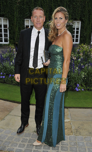 LONDON, ENGLAND - AUGUST 28: Ray Parlour &amp; guest attend the Mo Farah Foundation &quot;A Night Of Champions&quot; Dinner, The Hurlingham Club, Ranelagh Gardens, on Thursday August 28, 2014 in London, England, UK. <br /> CAP/CAN<br /> &copy;Can Nguyen/Capital Pictures