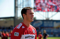 Chicago Blackhawks captain Jonathan Toews prepares to raise the supporter flag.  The LA Galaxy tied the Chicago Fire 1-1 at Toyota Park in Bridgeview, IL on September 4, 2010
