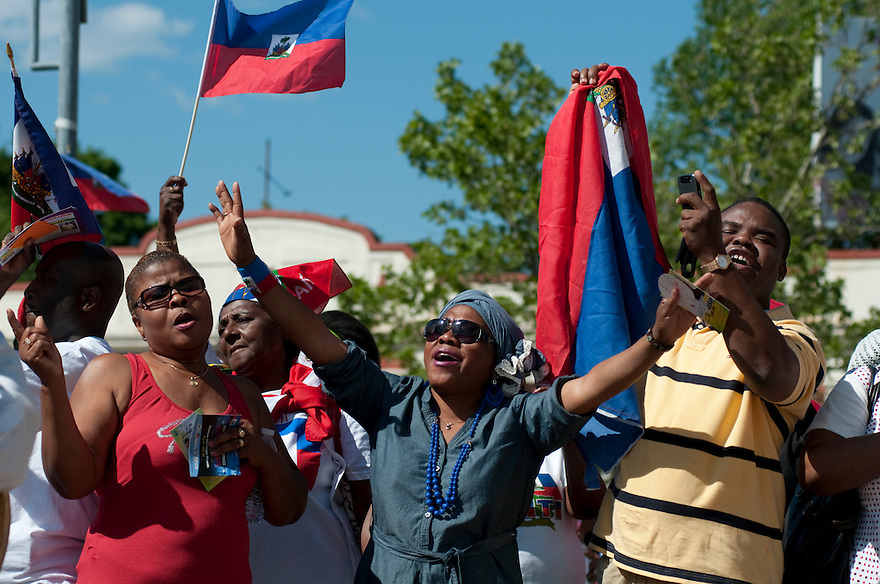 BOSTON, MA.-- Haitians and supporters sign the Haitian national anthem from left, Marie Pierre, Daniella Lunarque and Peter St. Laurent, at a celebration following the Haitian American Unity Parade Sunday. ..GLOBE PHOTO BY JODI HILTON
