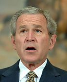 Washington, D.C. - May 8, 2006 -- United States President George W. Bush discusses the situation in Darfur, Sudan, in the Roosevelt Room of the White House on May 8, 2006. United States Deputy Secretary of State Robert Zoellick recently returned from Sudan where he helped put together a tenuous peace plan.  Bush said he was sending Rice to the United Nations on Tuesday to urge the Security Council to pass a resolution to seed the deployment of United Nations (U.N.) peacekeeping troops in Darfur to protect residents from further violence. He also said he had directed the acceleration of food and humanitarian assistance to Darfur and urged congress to approve an extra $225 million more in food aid as part of its emergency spending bill.<br /> Credit: Roger Wollenberg - Pool via CNP