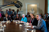 United States President Barack Obama, right, speaks during a cabinet meeting at the White House with Sylvia Mathews Burwell, secretary of the U.S. Department of Health and Human Services (HHS), from right, Arne Duncan, U.S. education secretary, Gina McCarthy, administrator of the U.S. Environmental Protection Agency (EPA), and Susan Rice, U.S national security advisor, in Washington, D.C., U.S., on Tuesday, July 1, 2014. Obama said yesterday he'll go it alone on changing U.S. immigration rules because House Republicans won't act. <br /> Credit: Andrew Harrer / Pool via CNP
