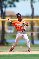 GCL Astros second baseman Juan Pineda (16) throws to first during a game against the GCL Nationals on August 14, 2016 at the Carl Barger Baseball Complex in Viera, Florida.  GCL Nationals defeated GCL Astros 8-6.  (Mike Janes/Four Seam Images)