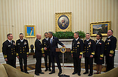 United States President Barack Obama shakes hands with Capt. Dan Beck, Deputy Commander of the PHS CC Ebola Response after meeting with members of the Public Health Service Commissioned Corps (PHS CC) after signing a citation awarding the Presidential Unit Citation to PHS CC members who participated in the Ebola containment efforts in West Africa, in the Oval Office at The White House in Washington, D.C., U.S., on Thursday, Sept. 24, 2015.<br /> Credit: Rod Lamkey Jr. / Pool via CNP