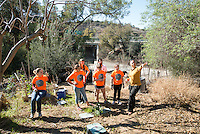 Students and an alum tour the top of Solano Canyon Community Garden, which is directly over the 110 freeway in Los Angeles.<br />