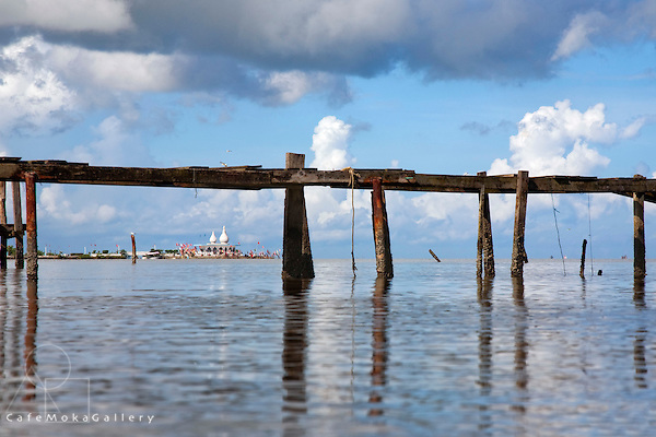Old wooden jetty at Brickfield fishing depot, Temple in the Sea in the distance