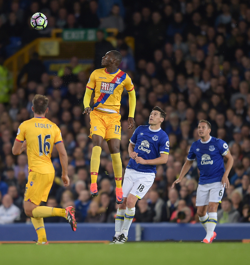 Crystal Palace's Christian Benteke heads the ball away from Everton's Gareth Barry<br /> <br /> Photographer Terry Donnelly/CameraSport<br /> <br /> The Premier League - Everton v Crystal Palace - Friday 30th September 2016 - Goodison Park - Liverpool<br /> <br /> World Copyright &copy; 2016 CameraSport. All rights reserved. 43 Linden Ave. Countesthorpe. Leicester. England. LE8 5PG - Tel: +44 (0) 116 277 4147 - admin@camerasport.com - www.camerasport.com