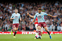 Mahmoud Hassan Trezeguet of Aston Villa tackled by Granit Xhaka of Arsenal during the Premier League match between Arsenal and Aston Villa at the Emirates Stadium, London, England on 22 September 2019. Photo by Carlton Myrie / PRiME Media Images.