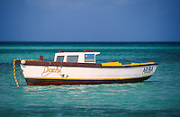 fishing boats anchored off fisherman's huts, Aruba, Netherlands Antilles