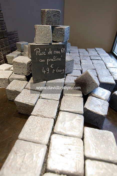 """Chocolate """"pavés"""" or paving stones, such as those thrown at the police during the May 1968 events, stand on display in the window of Patrick Roger's chocolate store in Paris, France, 2 May 2008."""