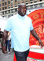 NEW YORK, NY - JULY 13: Shaquille O'Neal celebrates the 80th Anniversary of Krispy Kreme handing out free doughnuts on Times Square in New York City on July 13, 2017. Credit: RW/MediaPunch