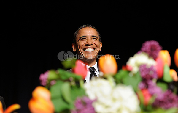 US President Barack Obama smiles during the White House Correspondents' Association Dinner at the Washington Hilton in Washington, DC, on Saturday, May 1, 2010.<br /> Credit: Olivier Douliery / Pool via CNP /MediaPunch