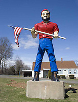 Muffler Man holding an American flag in rural Connecticut
