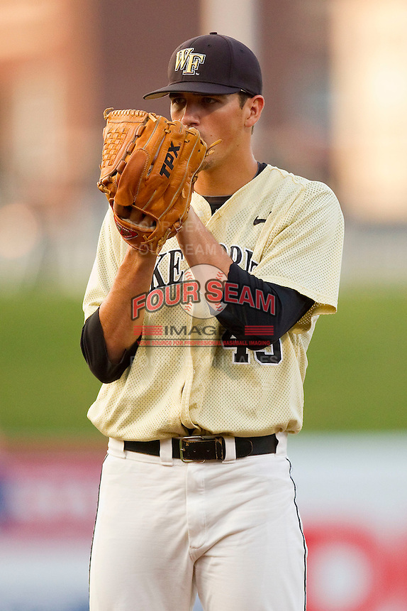 Wake Forest Demon Deacons starting pitcher Brian Holmes #45 looks to his catcher for the sign against the Miami Hurricanes at NewBridge Bank Park on May 25, 2012 in Winston-Salem, North Carolina.  The Hurricanes defeated the Demon Deacons 6-3.  (Brian Westerholt/Four Seam Images)