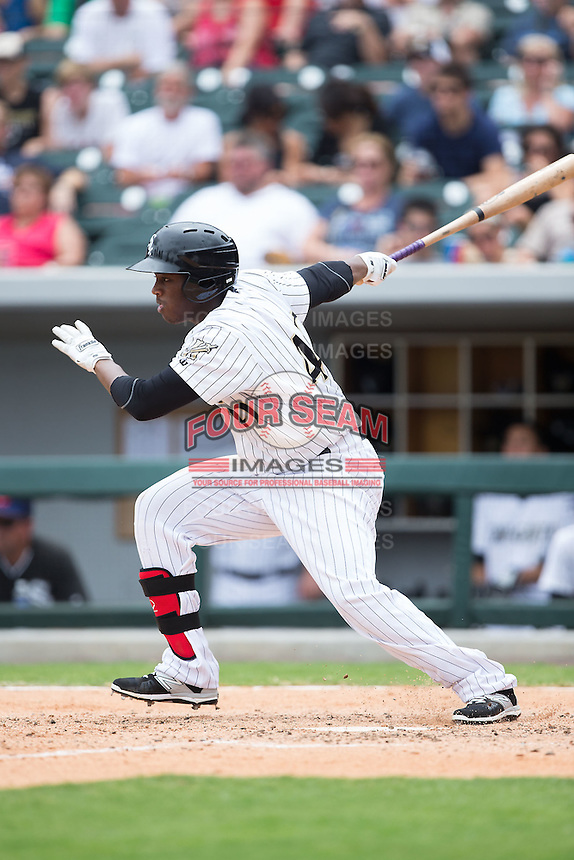 Alexander Simon (40) of the Charlotte Knights follows through on his swing against the Gwinnett Braves at BB&T BallPark on July 3, 2015 in Charlotte, North Carolina.  The Braves defeated the Knights 11-4 in game one of a day-night double header.  (Brian Westerholt/Four Seam Images)