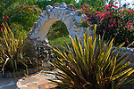 Stone arch and garden at Leo Carillo Ranch Historic Park, near Carlsbad, San Diego County, California