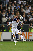 Los Angeles Galaxy's David Beckham and New York Red Bulls (60) Jeff Parke go for a header during play at the Home Depot Center in Carson, Ca on Saturday, May 10, 2008. N.Y 2, L.A. 1.