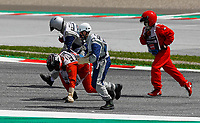 12th July 2020; Styria, Austria; FIA Formula One World Championship 2020, Grand Prix of Styria race day; FIA Formula One World Championship 2020, Grand Prix of Styria, Marshalls on the track pick up debris from the collission between LeClerc and Vettel on, lap 1 which retired both cars