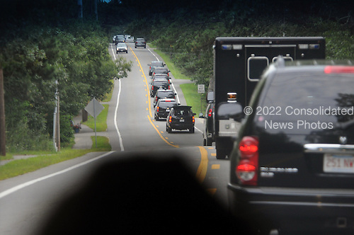 The motorcade of President Barack Obama travels along Edgartown West Tisbury Road August 18, 2013 in Edgartown, Massachusetts. The Obama's are spending their last day in the island of Martha's Vineyard before returning to DC. <br /> Credit: Darren McCollester / Pool via CNP