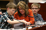 Toni Richard, of Reno, and her sons Tyler, 14, and Kyle, 12, testify in the Senate Finance committee hearing at the Legislative Building in Carson City, Nev., on Thursday, Feb. 12, 2015. The boys, who are both autistic, urged lawmakers not to cut funding to state autism programs.<br /> Photo by Cathleen Allison