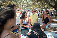 Occidental College students browse the tables at the Involvement Fair in the Academic Quad, Sept. 7, 2017. The annual event is an opportunity for students to learn about and join student-run clubs that offer a wide variety of interests.<br /> (Photo by Marc Campos, Occidental College Photographer)