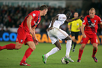 Pictured: Eder of Swansea (C) against Dave Winfield (L) and Luke Summerfield of York (R) Tuesday 25 August 2015<br /> Re: Capital One Cup, Round Two, Swansea City v York City at the Liberty Stadium, Swansea, UK.