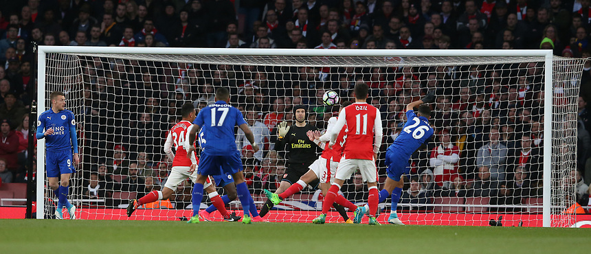 Arsenal's goalkeeper Petr Cech palms this shot from Leicester City's Riyad Mahrez (right #26) over the bar<br /> <br /> Photographer Stephen White/CameraSport<br /> <br /> The Premier League - Arsenal v Leicester City - Wednesday 26th April 2017 - Emirates Stadium - London<br /> <br /> World Copyright &copy; 2017 CameraSport. All rights reserved. 43 Linden Ave. Countesthorpe. Leicester. England. LE8 5PG - Tel: +44 (0) 116 277 4147 - admin@camerasport.com - www.camerasport.com