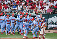 NWA Democrat-Gazette/CHARLIE KAIJO Ole Miss catcher Cooper Johnson (13) scores during game two of the College Baseball Super Regional, Sunday, June 9, 2019 at Baum-Walker Stadium in Fayetteville. Ole Miss forces a game three with a 13-5 win over the Razorbacks