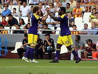 Valencia, Spain. Thursday 19 September 2013<br /> Pictured: Wilfried Bony of Swansea (R) celebrating his opening goal with team mate Jose Canas (L)<br /> Re: UEFA Europa League game against Valencia C.F v Swansea City FC, at the Estadio Mestalla, Spain,