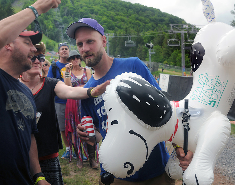 """a distinctive inflated """"Snoopy"""" figure on a stick brought by a member of the audience during a performance of, The Mother Hips, Mountain Jam Music Festival of 2015, in Hunter, NY on Friday June 5, 2015. Photo by Jim Peppler. Copyright Jim Peppler 2015."""